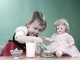 1950s Little Girl and Baby Doll Having Tea Party Photographic Print