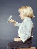 1950s-1960s Girl with Pet Bird Parakeet on Her Finger Photographie
