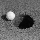 1950s Close-Up of Golf Ball on Green on Very Edge of Cup Photographic Print