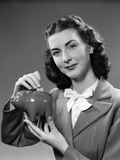 1940s Woman Putting Change into Piggy Bank Photographic Print