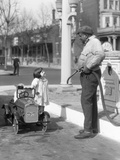 1920s Little Girl Standing Beside Her Pedal Car Asking for Gasoline Photographie