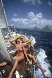 1990s Couple Sitting on Bow of Sailboat Saint Lucia West Indies Photographic Print