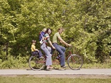 1970s Family on Tandem Bicycle Mother Father Son and Baby Daughter Photographic Print