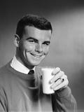 1960s Young Man Holding Glass of Milk Lámina fotográfica