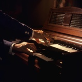 1970s Hands Playing a Wurlitzer Organ Keyboard Photographic Print