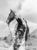 1930s Cowboy Sitting in Front of Horse Holding Reins Spotted Paint Pinto Photographic Print