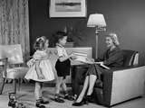 1950s Little Boy and Girl Giving Woman Sitting in Living Room a Gift Photographic Print