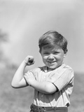 1930s Boy Making Strong Muscle Flexing Arm Photographic Print