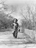 1940s Boy Walking Down Country Road with Can of Worms and Fishing Pole Photographie
