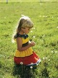 1980s Little Blond Girl Wearing Red and Yellow Sun Dress Kneeling on Grass Photographic Print