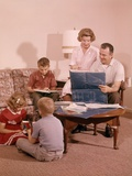 1960s Family in Living Room Looking at New House Blueprint Plans Photographic Print