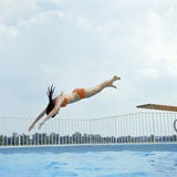 1970s Teen Girl Diving into Swimming Pool Photographic Print