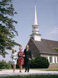 1960s Smiling Family Leaving Church Each Carrying Bible Photographic Print