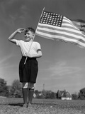 1940s Boy Holding American Flag Saluting Wearing Short Pants Photographic Print