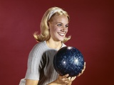 1960s Young Blonde Woman Holding Bowling Ball Wearing Blue Sweater Photographic Print