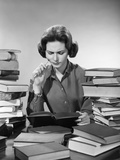 1950s-1960s College Woman Studying Surrounded All around by Piles of Books Photographic Print