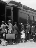 1920s Family Boarding Passenger Train Assisted Photographic Print