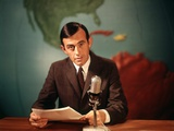 1960s Reporter Reading News into Microphone with Global Map in Background Photographic Print