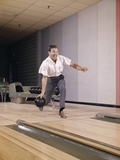 1960s Man Bowling Indoor About to Release Ball in Alley Photographic Print