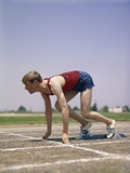 1960s-1970s Profile Athlete Runner in Starting Block at Beginning of Race Photographic Print