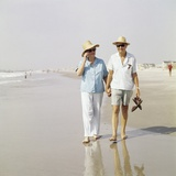 1970s Senior Couple Walking Beach Holding Hands Wearing Straw Hats Photographic Print