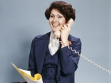 1970s Smiling Woman Wearing a Business Suit Talking on Telephone Photographic Print