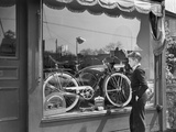 1950s Boy on Sidewalk Looking at Bicycle in Store Window Photographic Print
