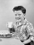 1930s-1940s Freckle-Faced Boy Sitting Dinner Table Holding Glass Milk Lámina fotográfica