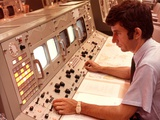 1970s Man Sitting at Control Panel of NASA Mission Control Photographic Print