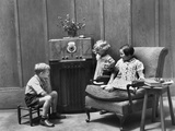 1930s Two Little Girls and a Boy Sitting in Living Room Listening to Radio Photographic Print