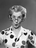 1950s-1960s Portrait Woman Polka Dot Dress Looking over Eyeglasses Photographic Print