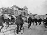 Los Angeles Police Officers Bicycling Past Broadway Storefronts Photographic Print