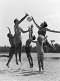 1960s Family Jumping Playing Beach Volleyball Photographic Print