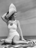 1940s Woman in White Bathing Suit on Beach Wearing Big Straw Hat Photographic Print