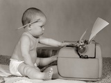 1960s Businesslike Baby with Pencil Behind Ear Typing on Typewriter Photographic Print