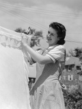 1940s Woman Hanging Laundry on Clothesline Outdoors Photographic Print