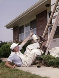 1960s Man Painter Shouting in Pain after Fall from Ladder at House Photographic Print
