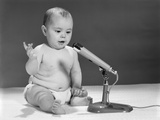 1960s Baby in Diaper Speaking into Microphone Photographic Print