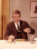1960s Man Eating Dinner at Table with Fork Full of Peas Photographic Print