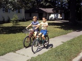 1970s Two Boys Riding Bikes Down Suburban Neighborhood Sidewalk Fotoprint