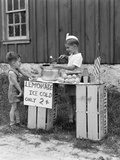 1930s-1940s Boy with Lemonade Stand Selling to Little Boy in Short Pants Photographic Print
