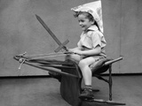1930s Boy Playing Wooden Sword Paper Hat Riding Chair Like a Horse Photographic Print