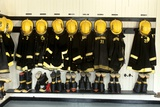 1990s Firefighter Gear Hanging in Firehouse Photographic Print
