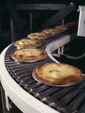 1970s Pies on Conveyor in Bakery Photographic Print