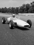 1960s Lotus Ford Race Car Speeding around Track Photographic Print