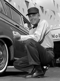 1950s-1960s Gas Station Attendant Checking Tire Pressure Photographic Print