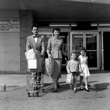 1950s Family Walking Out of Supermarket Store Photographic Print