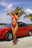1980s Woman in Red Swimsuit in Front of Red Sports Car Photographic Print