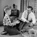 1950s Father and Son Playing with Cowboy Toy Game in Living Room Indoor Photographic Print