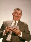 1960s Satisfied Man Looking at Hand of Playing Cards Photographic Print